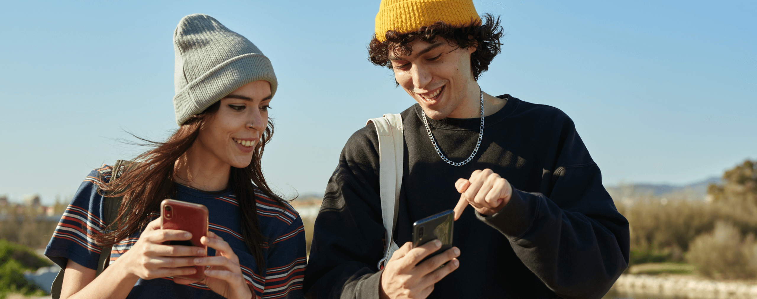 couple engaging with brand authenticity on phones